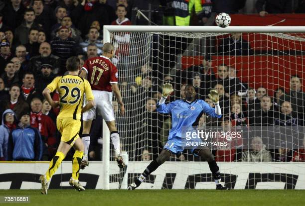 Manchester United's Swedish forward Henrik Larsson scores past Lille goalkeeper Tony Sylva during their UEFA Champions League first knockout round...