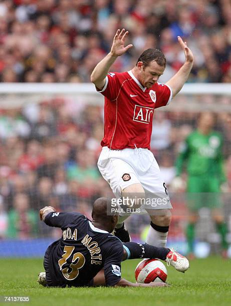 Manchester, UNITED KINGDOM: Manchester United's Wayne Rooney challenges West Ham's Luis Boa Morte during their English Premiership football match at...