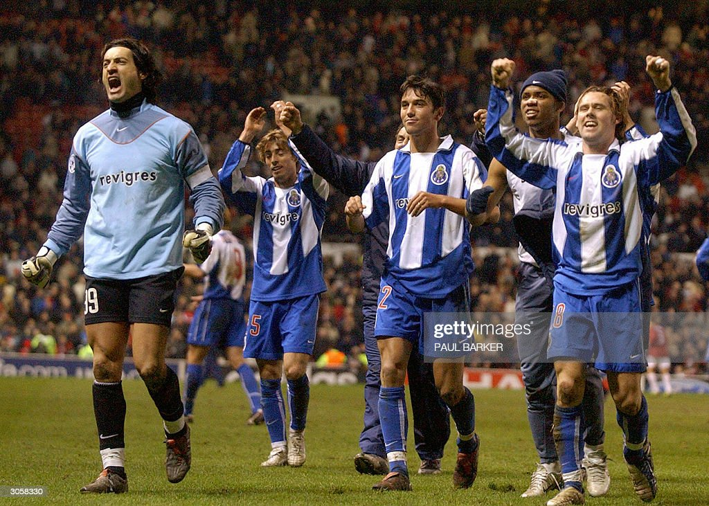 Porto salutes their fans after defeating Manchester United in the final minute to put Porto through to the next round during their Champions League second leg match at Old Trafford, Manchester, United Kingdom 09 March, 2004. Porto tied 1-1 but advance 3-2 on aggregate.