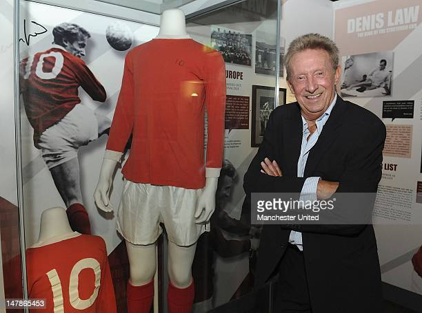 Manchester United legend Denis Law opens an exhibition to mark the 50th anniversary of his signing for Manchester United at the club museum at Old...
