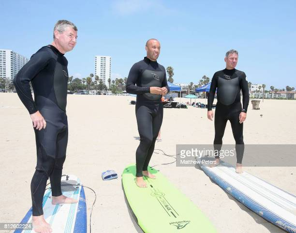 Manchester United legends Denis Irwin Bryan Robson Mikael Silvestre and David May take part in a surfing lesson as part of their preseason tour of...