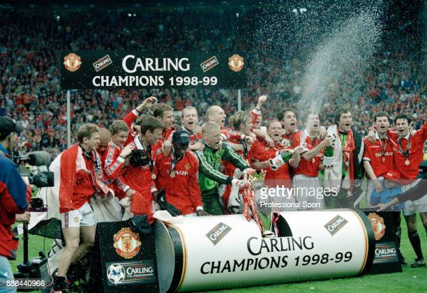 Manchester United line up for a group photo after winning FA Carling Premiership after the last home game of the season against Tottenham Hotspur at...