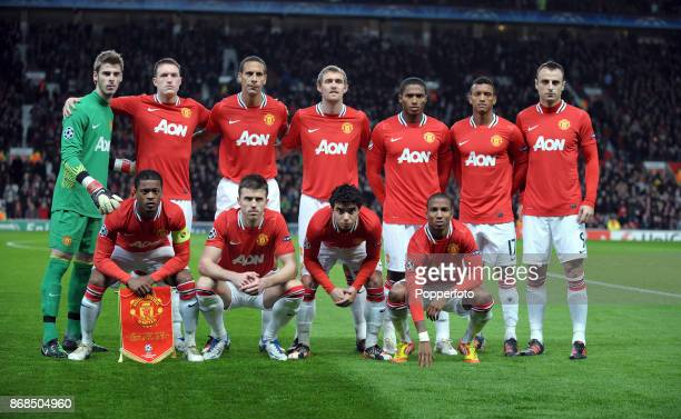 Manchester United line up for a group photo before the UEFA Champions League match between Manchester United and SL Benfica at Old Trafford on...