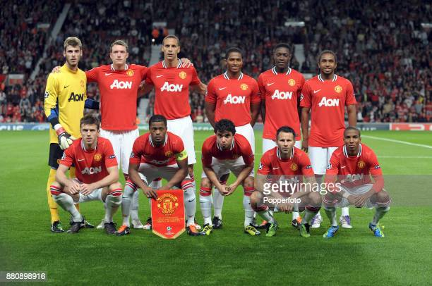 Manchester United line up for a group photo before the UEFA Champions League match between Manchester United and FC Basel at Old Trafford on...