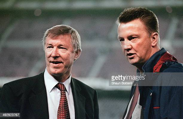 Manchester United manager Alex Ferguson and Barcelona coach Louis Van Gaal chat before the UEFA Champions League match between Barcelona and...