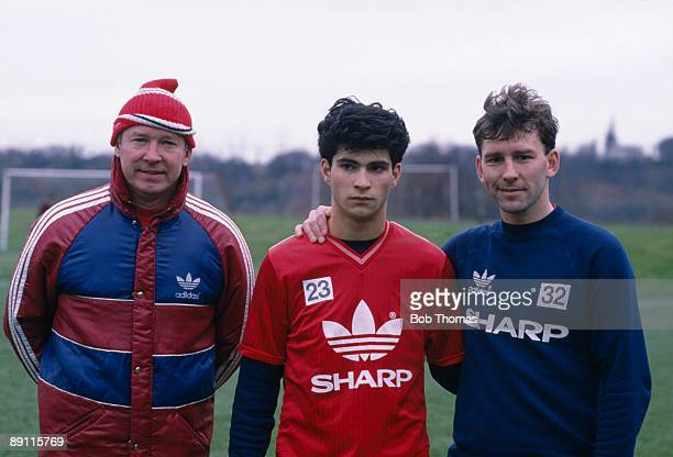 Manchester United manager Alex Ferguson and captain Bryan Robson welcome new signing Giuliano Maiorana at the Cliff training ground in Manchester 8th...