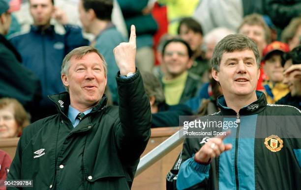 Manchester United manager Alex Ferguson and his assistant Brian Kidd circa 1997