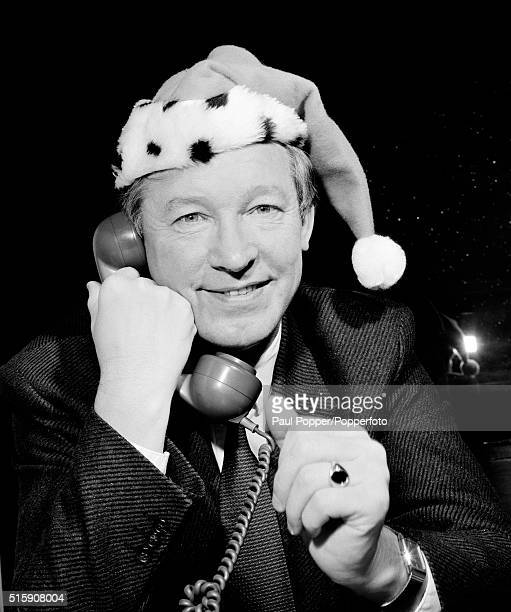 Manchester United manager Alex Ferguson getting in the mood for Christmas, circa December 1996.