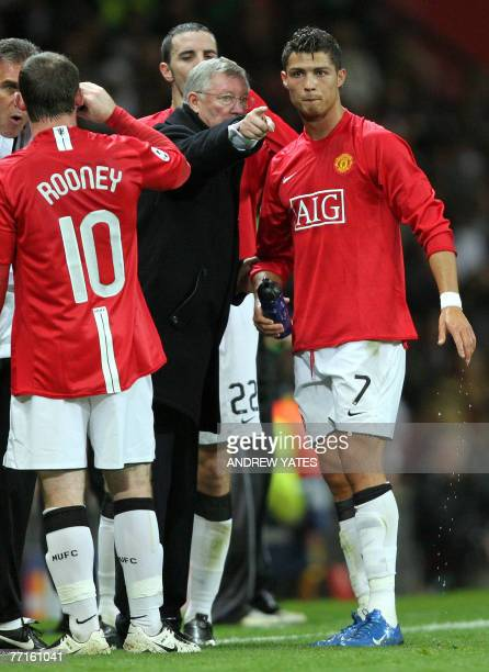 Manchester United manager Alex Ferguson gives instructions to Cristiano Ronaldo as they challenge Roma during a UEFA Cup Champions League match at...
