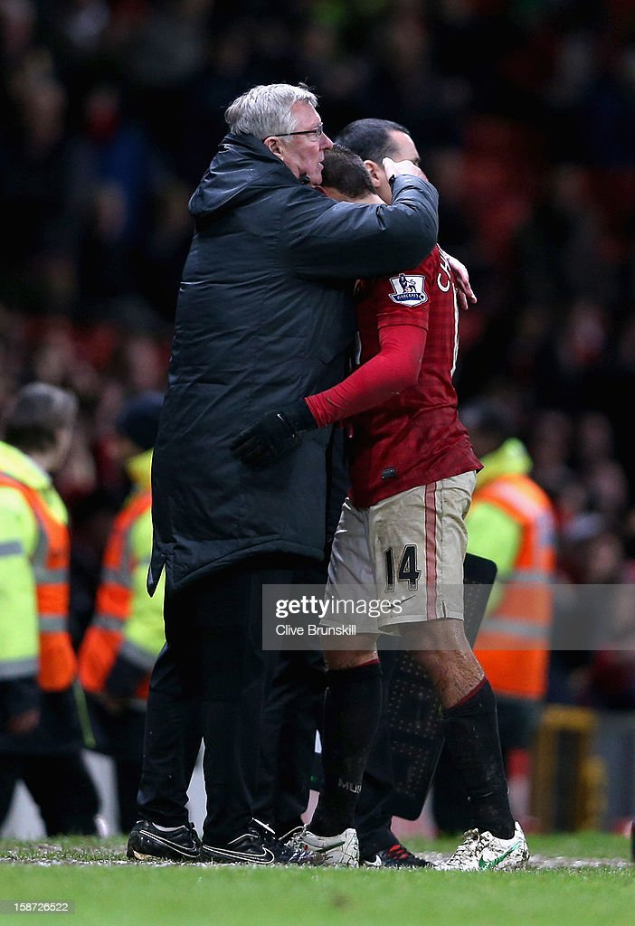 Manchester United manager Alex Ferguson hugs winning goal scorer Javier Hernandez during the Barclays Premier League match between Manchester United and Newcastle United at Old Trafford December 26, 2012 in Manchester, England.