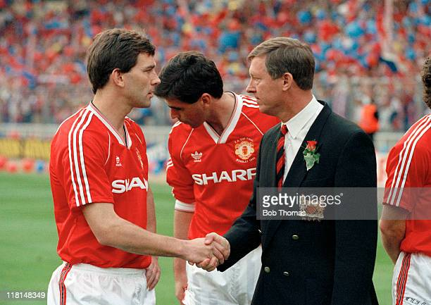 Manchester United manager Alex Ferguson shakes hands with his captain Bryan Robson as he wishes him good luck prior to the FA Cup Final Replay...