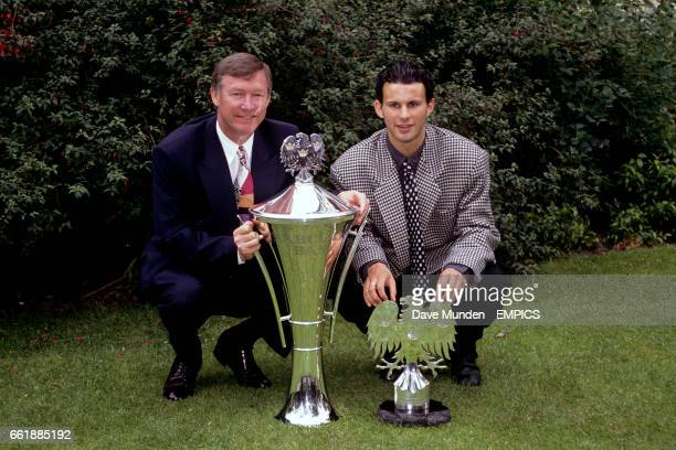 Manchester United manager Alex Ferguson shows off his Manager of the Year trophy alongside Ryan Giggs, proud recipient of the Young Eagle of the Year