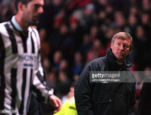 Manchester United manager Alex Ferguson watches Juventus leave the pitch at Old Trafford after his side were beaten in the UEFA Champions League...