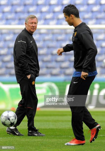 Manchester United manager Alex Ferguson watches Manchester United's Portugese midfielder Cristiano Ronaldo during a training session at the Estádio...