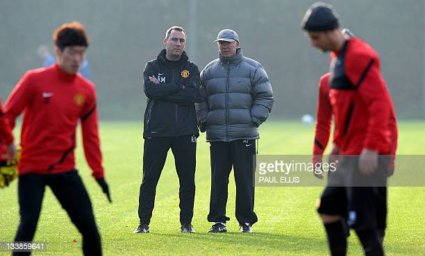 Manchester United manager Alex Ferguson watches players train in Manchester on November 21 on the eve of a UEFA Champions League Group C football...