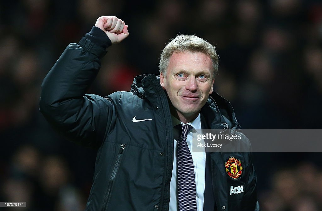 Manchester United Manager David Moyes celebrates at the end of the Barclays Premier League match between Manchester United and Arsenal at Old Trafford on November 10, 2013 in Manchester, England.
