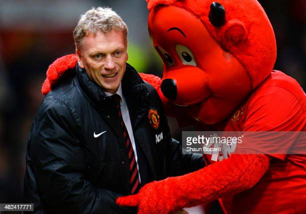 Manchester United Manager David Moyes is greeted by mascot Fred the Red prior to the Barclays Premier League match between Manchester United and...