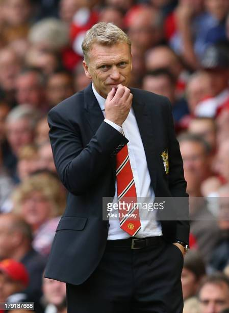 Manchester United Manager David Moyes looks on during the Barclays Premier League match between Liverpool and Manchester United at Anfield on...