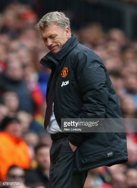 Manchester United Manager David Moyes reacts during the Barclays Premier League match between Manchester United and Liverpool at Old Trafford on...