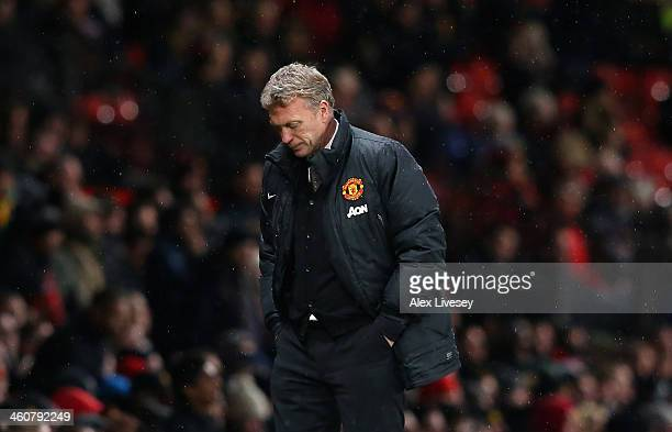 Manchester United Manager David Moyes reacts during the FA Cup with Budweiser Third round match between Manchester United and Swansea City at Old...