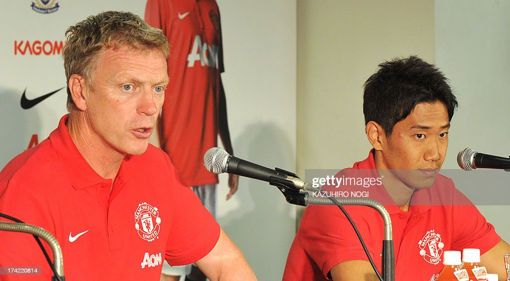 Manchester United manager David Moyes (L) speaks during a press conference prior to a training session at Nissan Stadium in Yokohama, suburban Tokyo on July 22, 2013 while Japanese player Shinji Kagawa (R) listens. The United will play Yokohama F Marinos on July 23 and then face Kagawa's former J-League club Cerezo Osaka at Nagai Stadium on July 26.