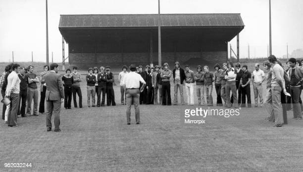 Manchester United manager Frank O' Farrell and coach Malcolm Musgrove talk to players as they report for training at the Cliff. July 1972.