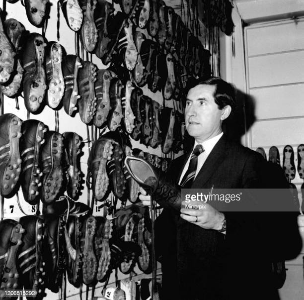 Manchester United manager Frank O'Farrell inspects the teams boots in the boot room 7th December 1973