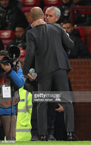 Manchester United Manager / Head Coach Jose Mourinho greets Manchester City Manager / Head Coach Pep Guardiola prior to the EFL Cup Fourth Round...