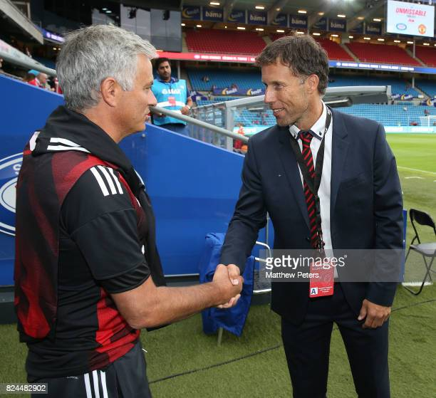 Manchester United Manager / Head Coach Jose Mourinho shakes hands with exUnited player Ronny Johnsen prior to the preseason friendly match between...