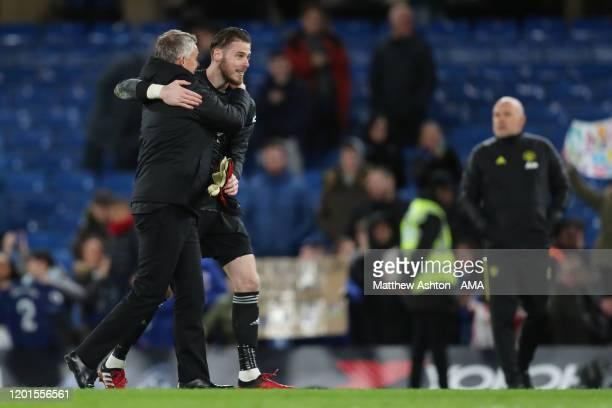 Manchester United manager / head coach Ole Gunnar Solskjaer and David de Gea at full time during the Premier League match between Chelsea FC and...