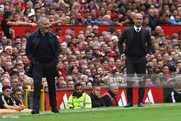 Manchester United Manager Jose Manager Jose Mourinho shouts instructions as Manchester City Manager Pep Guardiola looks on during the Premier League...