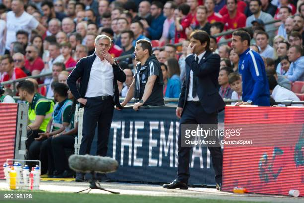 Manchester United manager Jose Mourinho and Chelsea manager Antonio Conte consult with their assistants during the Emirates FA Cup Final match...