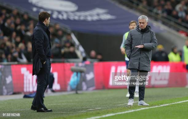 Manchester United manager Jose Mourinho and Tottenham manager Mauricio Pochettino during the Premier League match between Tottenham Hotspur and...