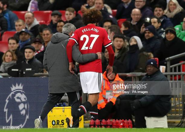 Manchester United manager Jose Mourinho consoles Marouane Fellaini after substituting him after just 8 minutes during the Premier League match at...