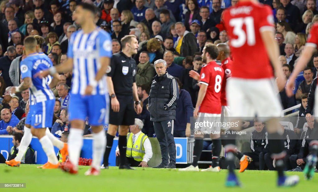 Manchester United manager Jose Mourinho (centre) during the Premier League match at the AMEX Stadium, Brighton.