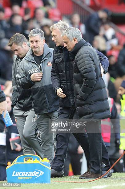 Manchester United manager Jose Mourinho greets his opposite number David Moyes during the Premier League match between Manchester United and...