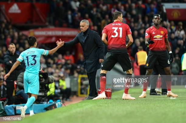 Manchester United Manager Jose Mourinho helps Yoshinori Muto of Newcastle United up from the sidelines during the Premier League match between...