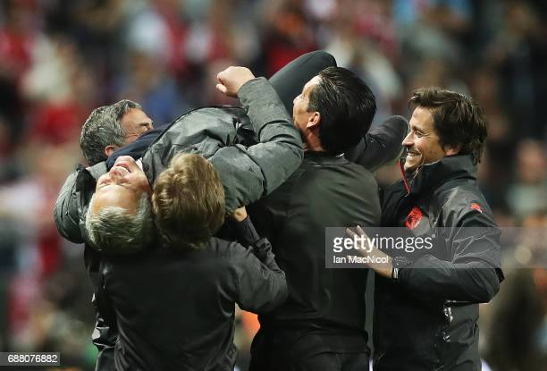 Manchester United manager Jose Mourinho is lifted up by back room staff during the UEFA Europa League Final match between Ajax and Manchester United...