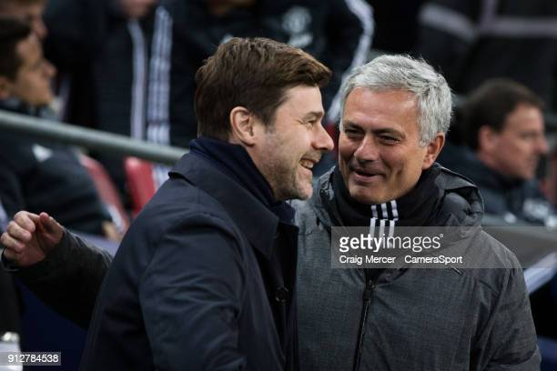 Manchester United manager Jose Mourinho jokes with Tottenham Hotspur manager Mauricio Pochettino before the Premier League match between Tottenham...