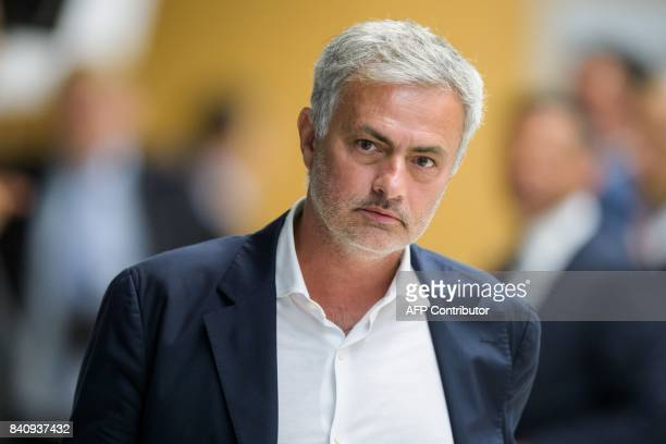 Manchester United manager Jose Mourinho leaves a session of the Elite Club Coaches Forum on August 30 2017 at the headquarters of European football...
