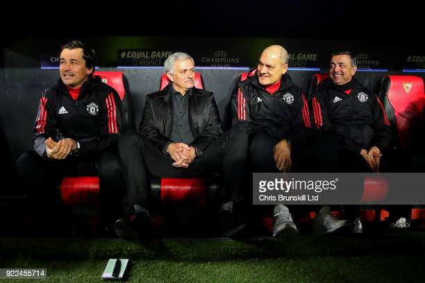 Manchester United manager Jose Mourinho looks on from the bench next to his assistants during the UEFA Champions League Round of 16 First Leg match...