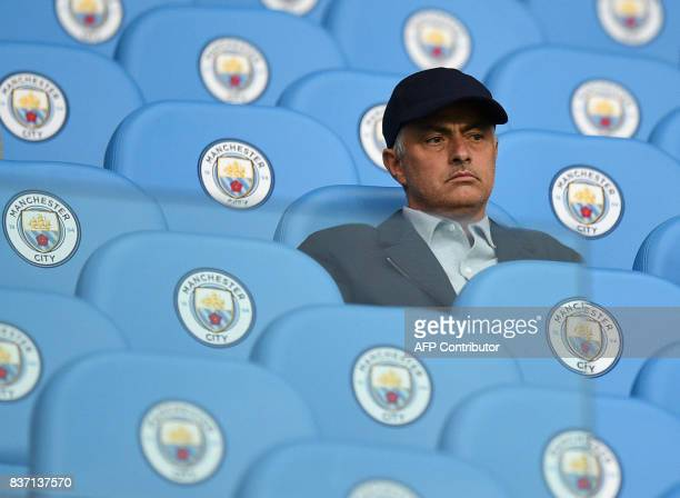 Manchester United manager Jose Mourinho looks on from the stands before the English Premier League football match between Manchester City and Everton...