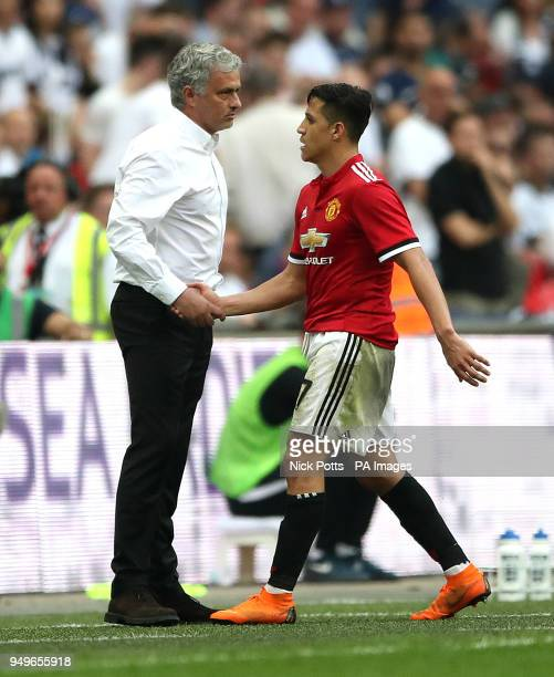 Manchester United manager Jose Mourinho shakes hands with Alexis Sanchez as he is substituted off the pitch during the Emirates FA Cup semifinal...