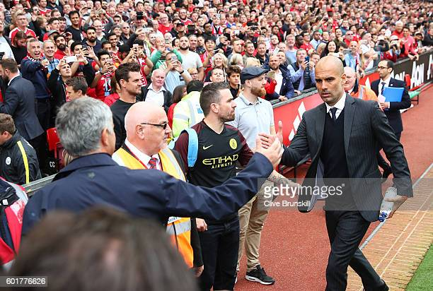 Manchester United manager Jose Mourinho shakes hands with Manchester City manager Pep Guardiola prior to the Premier League match between Manchester...
