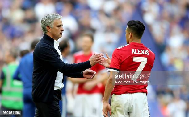 Manchester United manager Jose Mourinho shakes hands with Manchester United's Alexis Sanchez after the final whistle during the Emirates FA Cup Final...