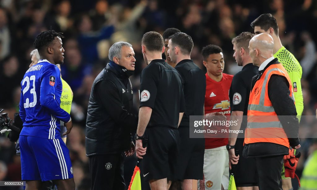 Manchester United manager Jose Mourinho speak to referee Michael Oliver at full time during the Emirates FA Cup, Quarter Final match at Stamford Bridge, London.