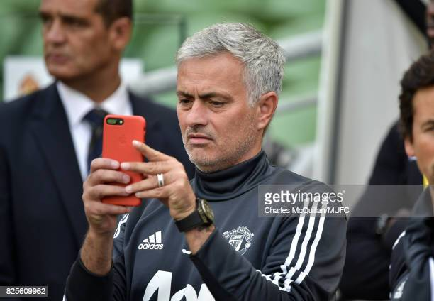 Manchester United manager Jose Mourinho takes a picture of the stadium with his smart phone before the Aon Tour pre season friendly game between...