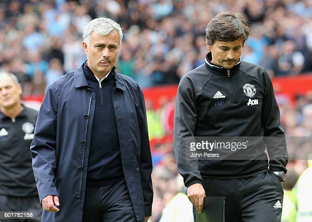 Manchester United Manager Jose Mourinho walks off with Assistant Manager Rui Faria at the end of the Premier League match between Manchester United...