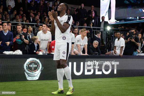 Manchester United manager Jose Mourinho watches from the sidelines as Jamaican sprinter Usain Bolt takes part in a 'Match Of Friendship' to promote...