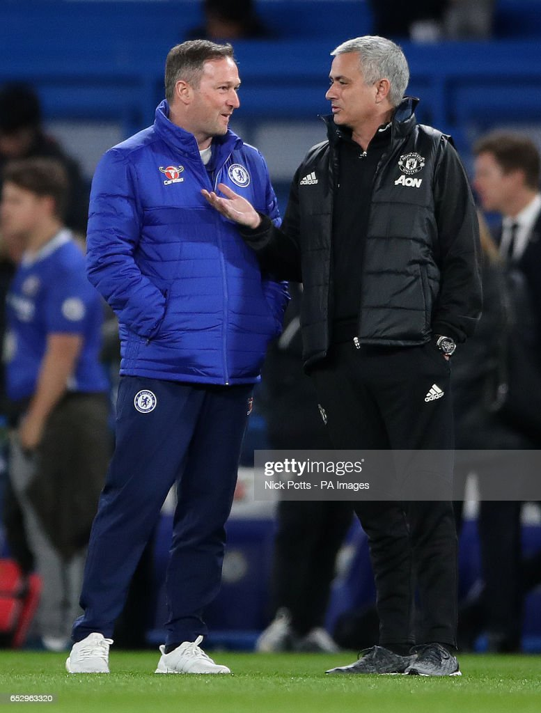 Manchester United manager Jose Mourinho with Chelsea coach Steve Holland during the Emirates FA Cup, Quarter Final match at Stamford Bridge, London.